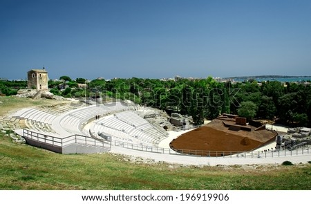 Old Greek theatre ruins in Syracuse, Sicily, italy.Old antique theatre ruins in Syracuse, historical place in Sicily on sunny summer day, old greek theatre. Panoramic view, Sicily  - stock photo