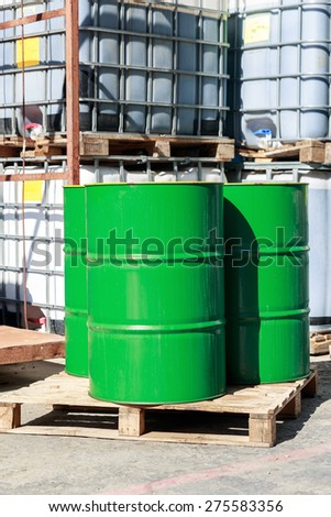 Old green barrels on a chemical plant - stock photo
