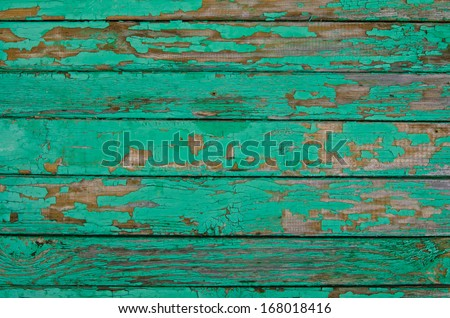 old green board with cracks - stock photo