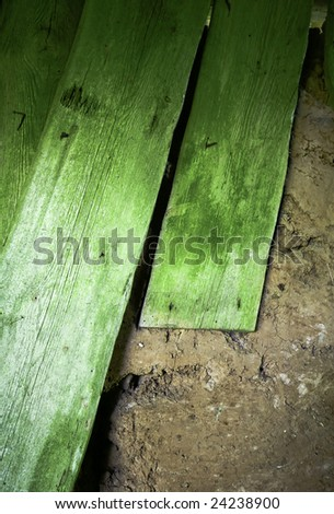 Old green planks in the barn - stock photo