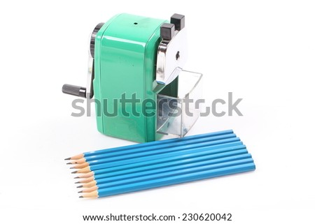 old green sharpener and blue pencil isolated on white background - stock photo