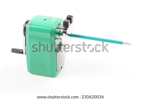 old green sharpener and colorful pencil isolated on white background