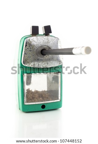 old green sharpener isolated on white background - stock photo