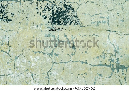 Old green wall with traces of paint and plaster. textural composition - stock photo