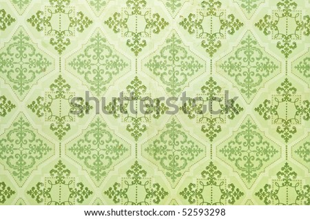 Old green wallpaper for texture or background
