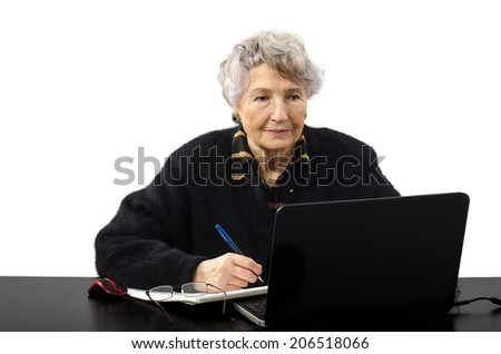 Old grey haired woman studying in internet