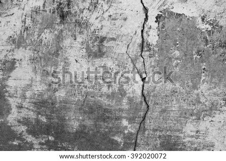 Old grey wall background. Grunge texture. Crack