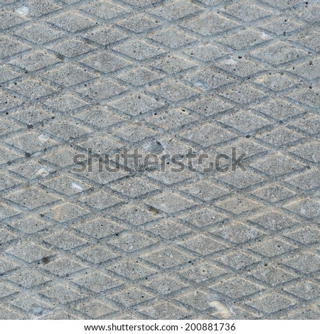 Old grey weathered concrete plate background rough grunge abstract cement tile texture diagonal groove pattern macro closeup diagonally grooved detailed textured gray sidewalk walkway pathway - stock photo