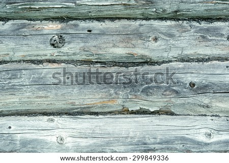 Old greyish wooden blockhouse texture. Background.