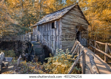 Old grist mill in Autumn in Smokey Mountains. - stock photo