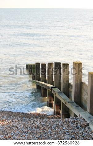 Old groin water breaker sea wall - stock photo