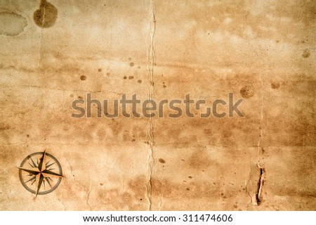 Old grunge blank paper sheet with compass rose - stock photo