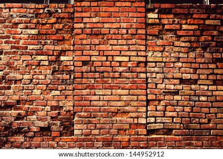 Old grunge brick wall background - stock photo