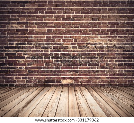 Old grunge brick wall with wooden floor - stock photo
