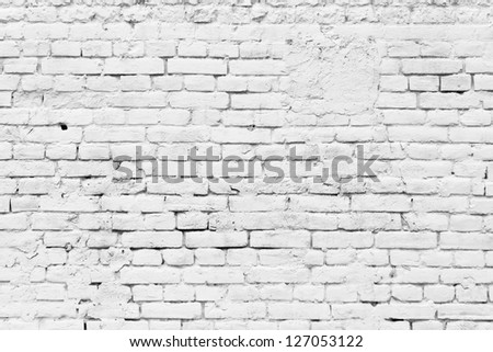 Old grunge brick white wall background - stock photo