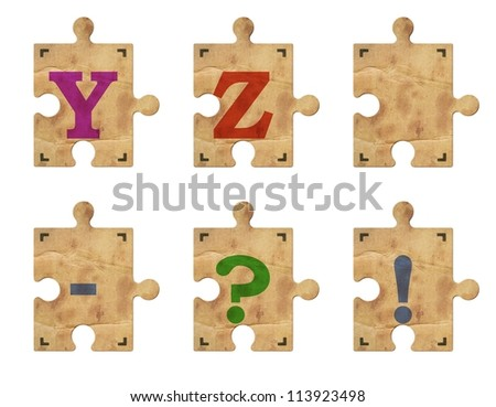 Old grunge cardboard jigsaw puzzle pieces with alphabet, Part 5