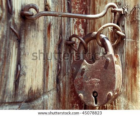Old grunge door lock - stock photo