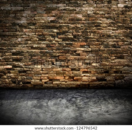 old grunge interior with brick wall - stock photo