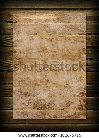 Old grunge paper on the wood background - stock photo