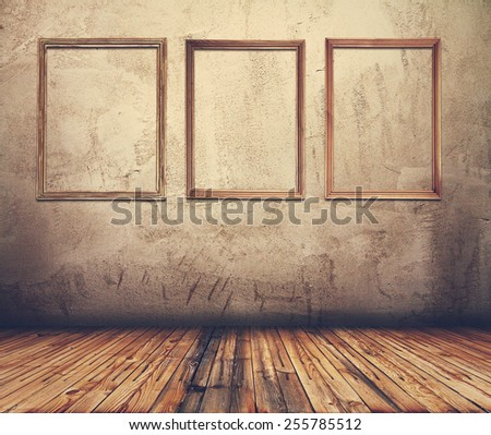 Old grunge room with picture frames, retro filtered, instagram style - stock photo