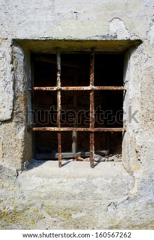 old grunge small window barred by rusty bar                    - stock photo