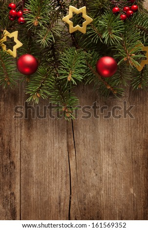 Old grunge wooden board  with Christmas border. - stock photo