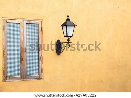 Old grunge wooden window on abandoned house - stock photo