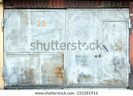 old grungy garage door - stock photo