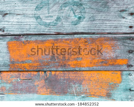 Old grungy painted wood background with weathered boards painted blue and orange with a wood grain texture, full frame - stock photo