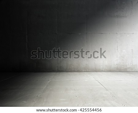 old grungy room with concrete wall - stock photo