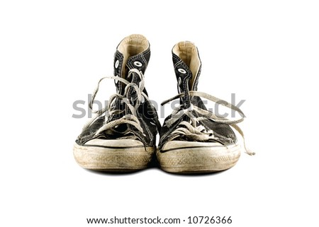 Old grungy sneakers isolated on white background - stock photo