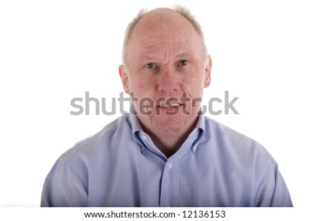 Old guy in blue shirt and small smile