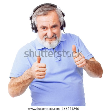 Old guy with headphones giving thumbs up - stock photo