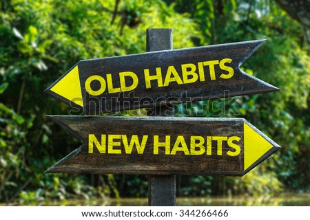 Old Habits - New Habits signpost with forest background - stock photo