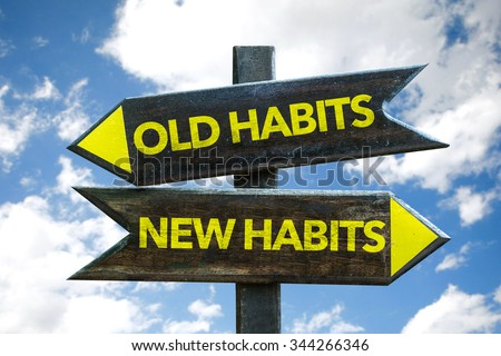 Old Habits - New Habits signpost with sky background - stock photo