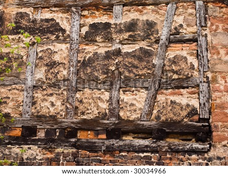 Old half-timbered wall in a German village - stock photo