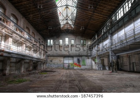 Old hall with a gate for locomotives - stock photo
