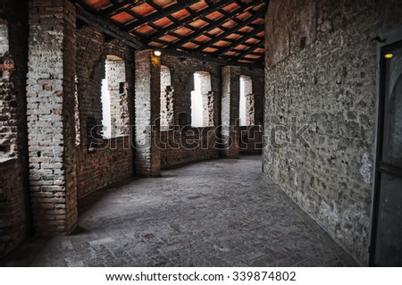 old hallway and brick wall seen from inside in hdr tone mapping effect - stock photo