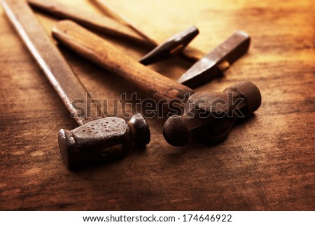 Old Hammers on a old wooden workdesk - stock photo