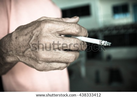 Old hand and cigarette  , Unhealthy,Cancer, Secondhand,Blurry portrait - stock photo