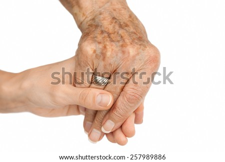 Old hand holding young hand, on white background - stock photo