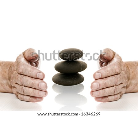 Old hands and stone tower between them. Isolated on white background - stock photo