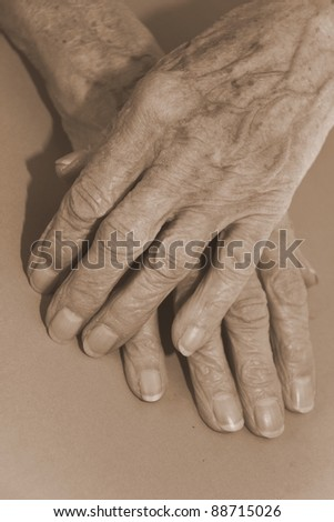 old hands showing hard work - stock photo