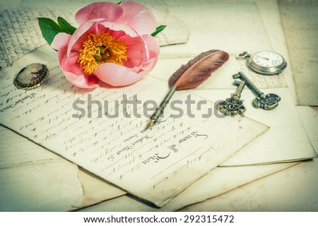 Old handwritings, antique feather pen, keys, pocket watch and pink peony flower. Sentimental vintage background. Retro style toned picture - stock photo