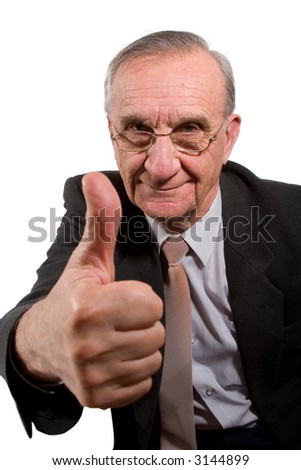 Old happy businessman with glasses showing thumb up sign
