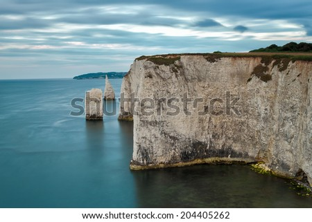 Old Harry Rocks on Jurassic Coast in Dorset England. - stock photo