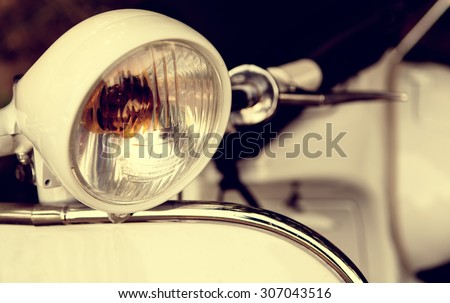 old headlight of scooter - stock photo