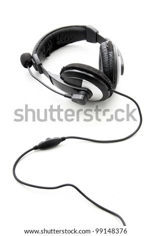 Old headphones on white background - stock photo
