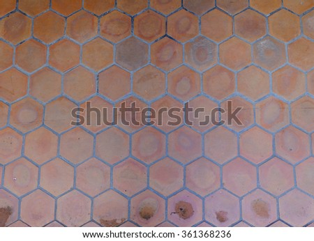 Old hexagonal clay tiles floor background - stock photo