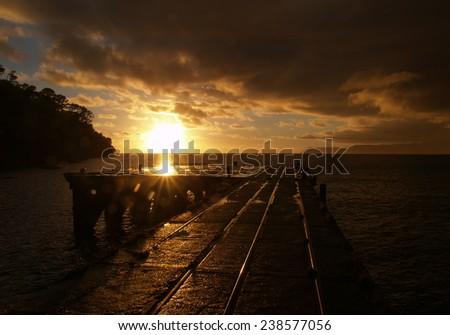 Old Hicks Bay wharf, New Zealand - stock photo